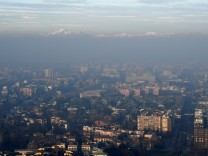 FILE PHOTO: Italian Alps are seen amidst dense fog and smog in Milan