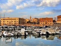 Trani, Apulia / Italy - 2014/08/24: Panoramic view of the Trani Adriatic Sea yacht port and marina with boats and yachts