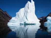 Iceberg floating in still fjord in east Greenland Kulusuk, Sermersooq Municipality, Greenland PUBLICATIONxINxGERxSUIxAUT