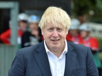 FILE PHOTO: British Prime Minister Boris Johnson speaks to local people at a heritage centre in Beeston near Nottingham, England