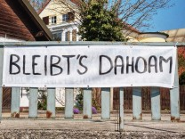 April 9, 2020, Munich, Bavaria, Germany: Bleibt s Dahoam , Bavarian for bleib daheim translates to stay home in English