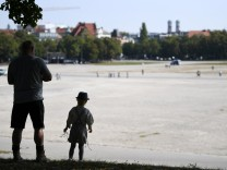 Man and boy stand on hill at Munich's Theresienwiese where Oktoberfest would have started
