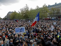 People pay tribute to beheaded teacher Samuel Paty in Paris