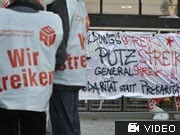 Streikende Gebäudereiniger, Foto: AP