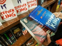 ViacomCBS looking to sell Simon & Schuster Novels by the Simon & Schuster author Stephen King on a bookshelf in a bookst