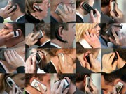 people using their cell phones;AP