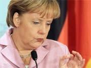 Merkel; dpa