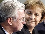 Angela Merkel, Roland Koch; ddp