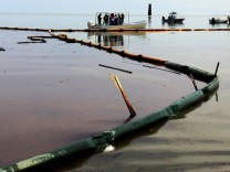 Oil floats on the surface in Pass A Loutre near Venice, Louisiana