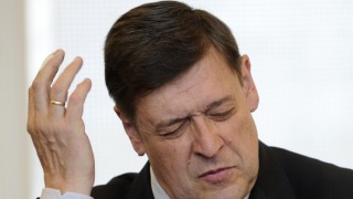 Former Social Democratic Party member of parliament Tauss reacts during his trial at the regional court in Karlsruhe