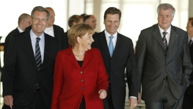 Bavarian state premier and CSU head Seehofer, German Chancellor and CDU head Merkel and Foreign Minister and FDP head Westerwelle present their candidate for presidential office Wulff in Berlin