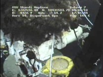 Frame grab shows leaking oil above the LMRP containment cap at the site of the Deepwater Horizon oil leak in the Gulf of Mexico
