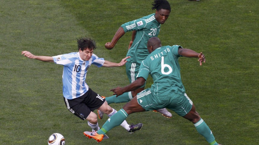 Argentina's Lionel Messi fights for the ball with Nigeria's Danny Shittu during a 2010 World Cup Group B soccer match at Ellis Park stadium