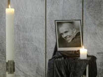 A photo of Hannover 96's Enke is seen in the chapel of the Schalke 04 stadium in Gelsenkirchen