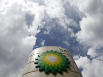 A BP logo is seen at a petrol station in central London