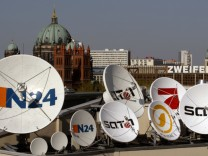 File picture shows satellite dishes of the German television stations Kabel 1 SAT 1 and ProSieben on the roof of the company's office in Berlin