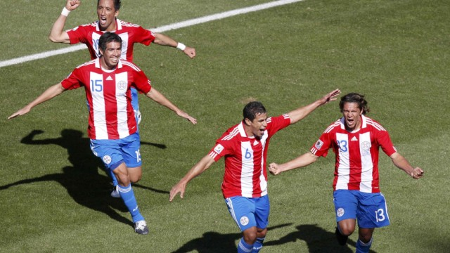 Paraguay's Vera celebrates with team mates after scoring during their 2010 World Cup Group F soccer match against Slovakia in Bloemfontein