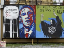 A wall painted with protests messages against BP and Obama in Grand Isle