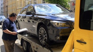 The damaged car of German presidential candidate Joachim Gauck is loaded on a tow truck after an accident in Munich