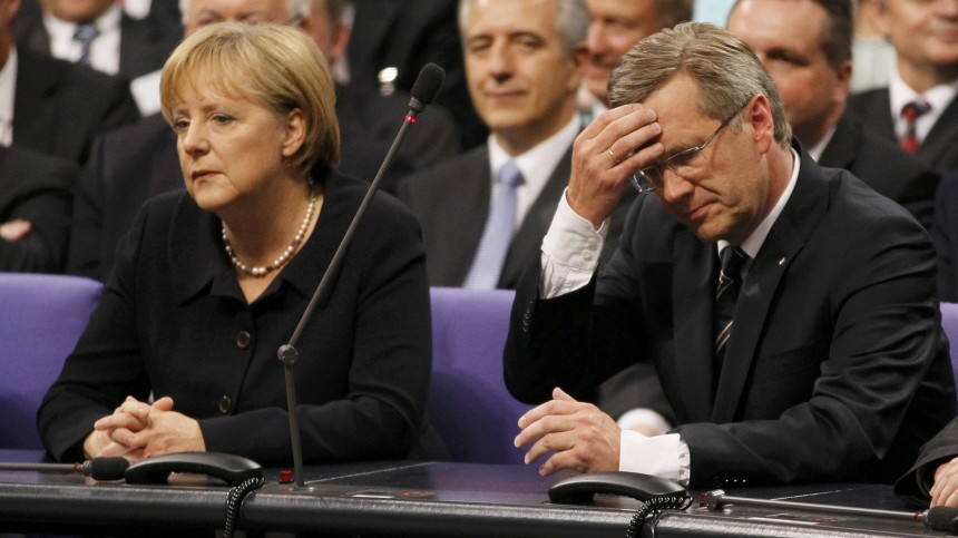 German Chancellor Merkel and CDU candidate Wulff wait to hear the result of the German presidential election at the Reichstag in Berlin