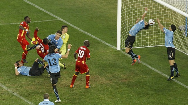 Uruguay's Luis Suarez saves the ball with his hands during a 2010 World Cup quarter-final soccer match at Soccer City stadium