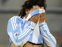 Argentina's Carlos Tevez wipes his face during the 2010 World Cup quarter-final soccer match against Germany at Green Point stadium in Cape Town