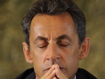 France's President Sarkozy attends a meeting with farmers in Brommat, Center France