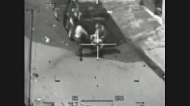 This image captured from a classified U.S. military video footage shows a wounded Iraqi person being loaded onto a van in Baghdad