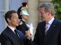 France's President Sarkozy welcomes German President Christian Wulff at the Elysee Palace in Paris