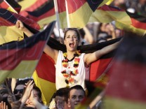 A soccer fan reacts during a screening of the 2010 World Cup third-place play-off soccer match between Germany and Uruguay at the 'Fan mile' public viewing area in Berlin