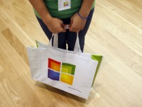 A worker holds a bag during the grand opening of Microsoft's first retail store in Scottsdale