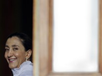 Colombian former guerrilla FARC hostage Ingrid Betancourt waits on a balcony before a meeting with President Hugo Chavez in Caracas