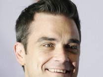 Take That wieder vereint - Robbie Williams kehrt zu seiner alten Band zurueck