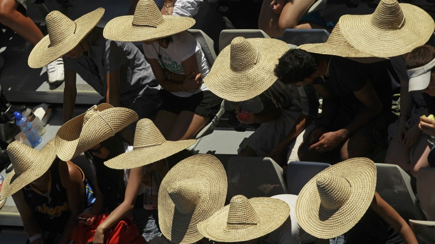 Spectators wear sombreros during the match between Petrova and Kuznetsova at the Australian Open in Melbourne