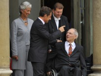France's President Sarkozy accompanies German Finance Minister Schauble after the weekly cabinet meeting at the Elysee Palace in Paris
