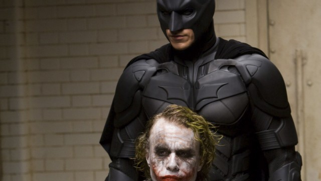 "Handout photo shows actor Heath Ledger starring as the Joker along with Christian Bale as Batman in the movie ""The Dark Knight"""