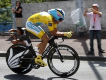 Astana team rider Alberto Contador of Spain cycles during the individual time-trial 19th stage of the Tour de France cycling race between Bordeaux and Pauillac