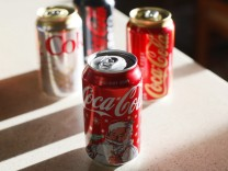 Coca-Cola products are displayed on a kitchen counter in Golden