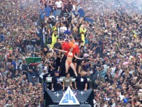 REVELLERS ATTEND THE LOVE PARADE IN BERLIN