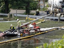Workers Clean Up And Try To Contain Oil Spill In Michigan