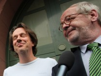 Swiss meteorologist and TV weather host Kachelmann leaves the district court in Mannheim