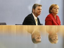 German Chancellor Merkel and Vice Chancellor and Foreign Minister Westerwelle hold a news conference in Berlin