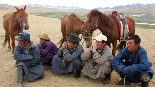 Mongolian nomads watch a polo practice match at Orkhon Valley near Kharkorin