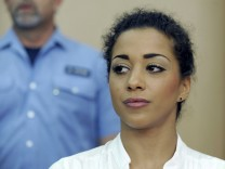 Benaissa German pop singer with the girlband 'No Angels' awaits the start of her trial in a courtroom in Darmstadt
