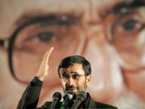 Iranian President Mahmoud Ahmadinejad gestures in Tehran