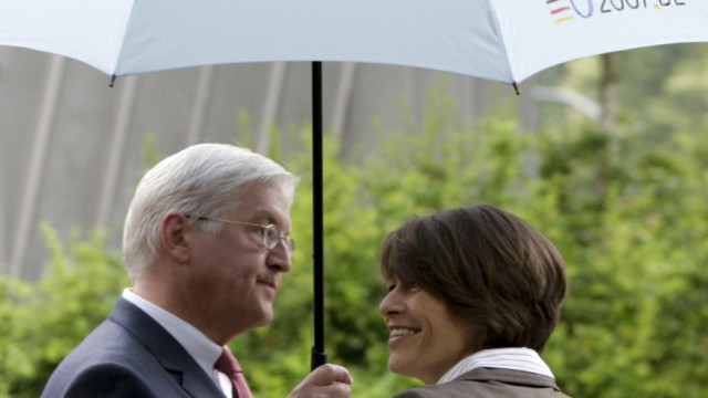 Steinmeier and his wife leave polling station after voting during European Parliament elections in Berlin