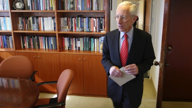 Bank of Israel Governor Stanley Fischer enters his office for an interview with Reuters in Jerusalem