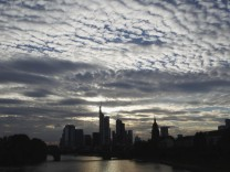The skyline of Frankfurt is pictured under clouds