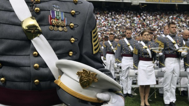 The graduating class at the U.S. Military Academy at West Point stand in attention during the 2010 commencement ceremony at Mitchie Stadium at West Point, New York