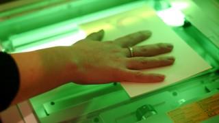 Hand auf Kopierer